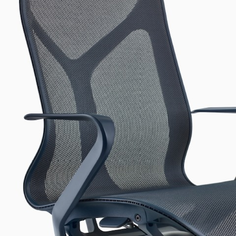 A high-back Cosm Chair with fixed arms and Nightfall dark blue frame and suspension material.