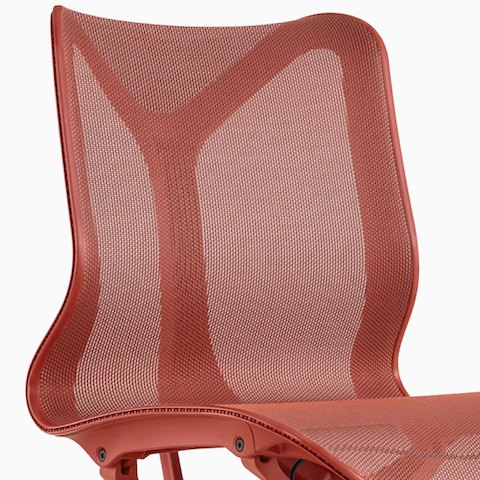 A low-back Cosm Chair with no arms and Canyon red frame and suspension material.