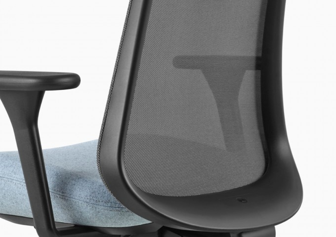 Close up image of a black and light blue Lino Chair, viewed from the back at an angle.