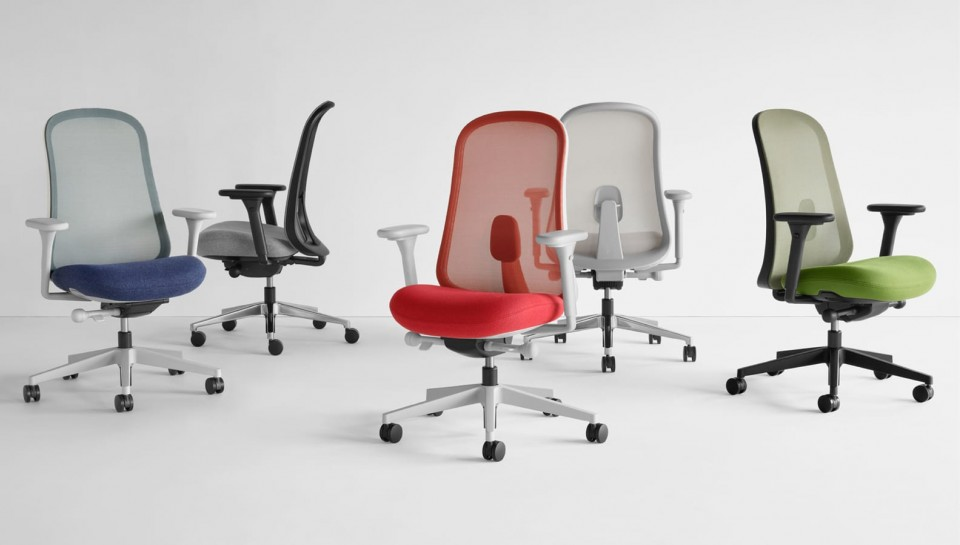Five Lino Chairs in blue, black, grey, red and green viewed from various angles.