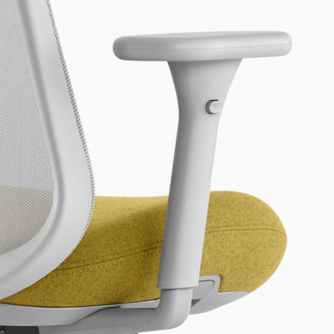Close up image of a grey and yellow Lino Chair with adjustable sacral lumbar support and adjustable height arms, viewed from the back at an angle.