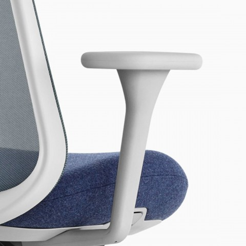 Close up image of a grey and blue Lino Chair with suspension back and fixed arms, viewed from the back at an angle.