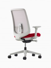 A Verus Chair with a suspension back, red seat and mineral frame viewed at an angle.