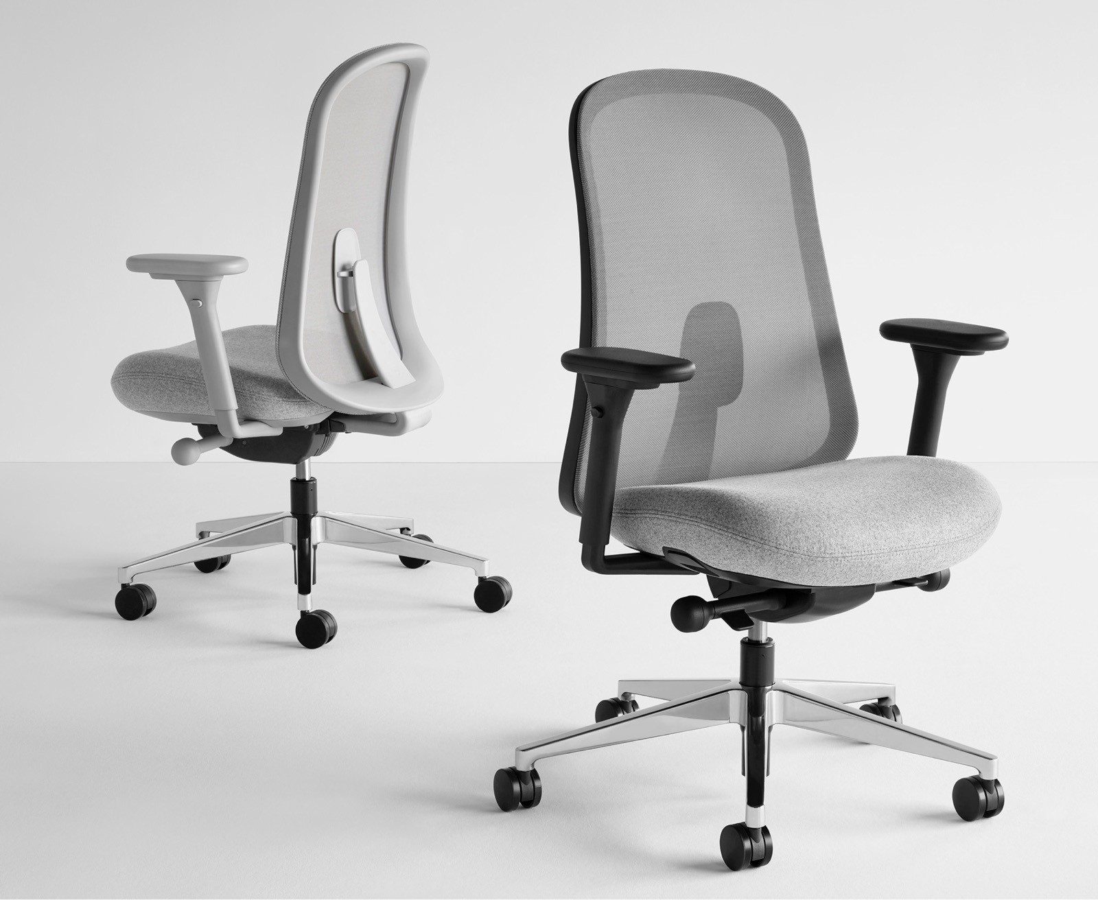 Two black and grey Lino Chairs with adjustable sacral lumbar support, viewed from the front and back at angles.